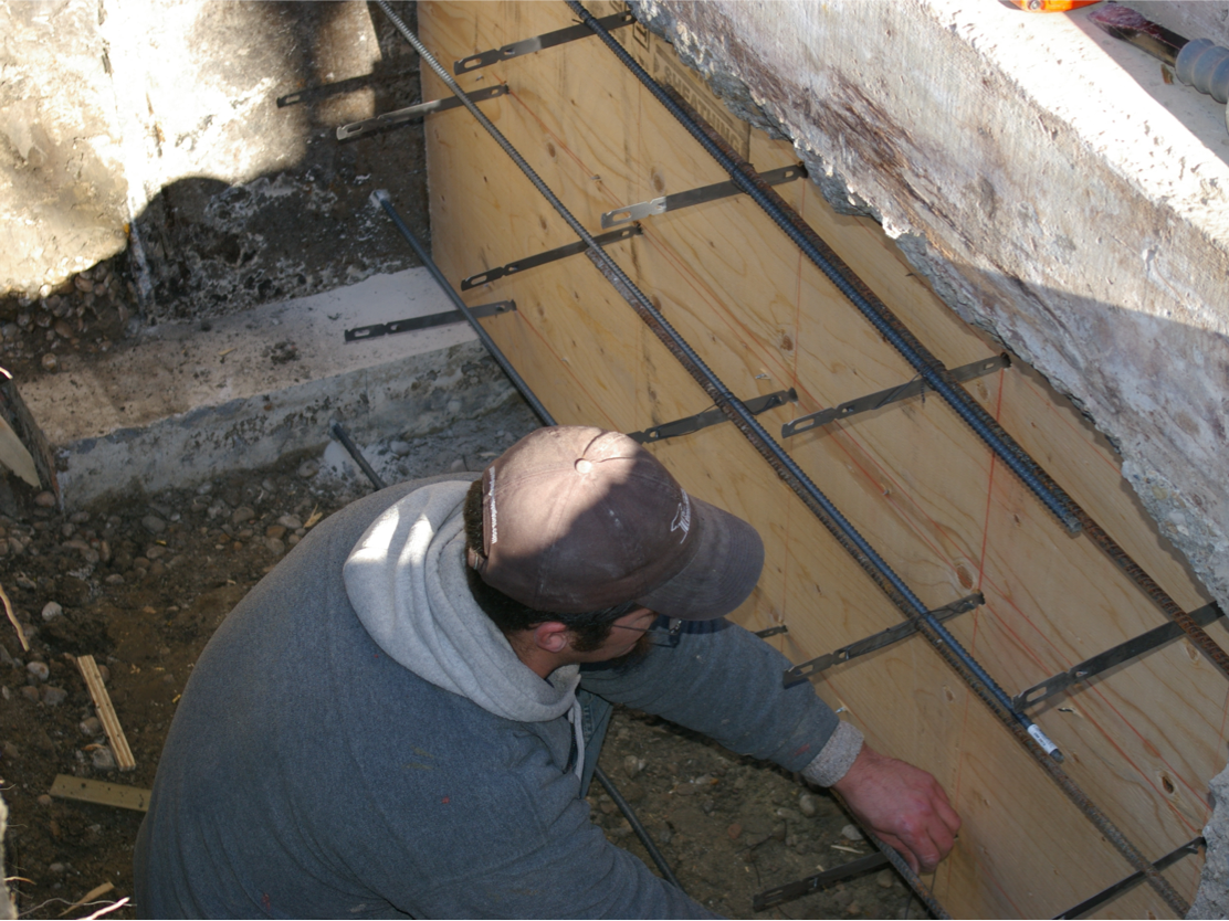 Installing snap ties on a foundation repair